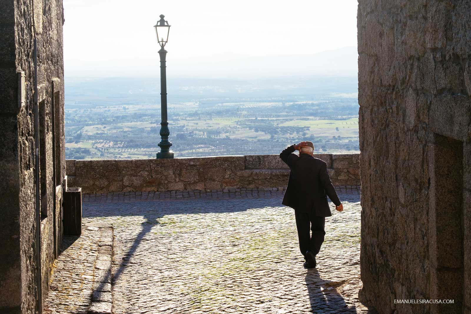 An elderly man walks towards a panoramic point in Monsanto, 2016