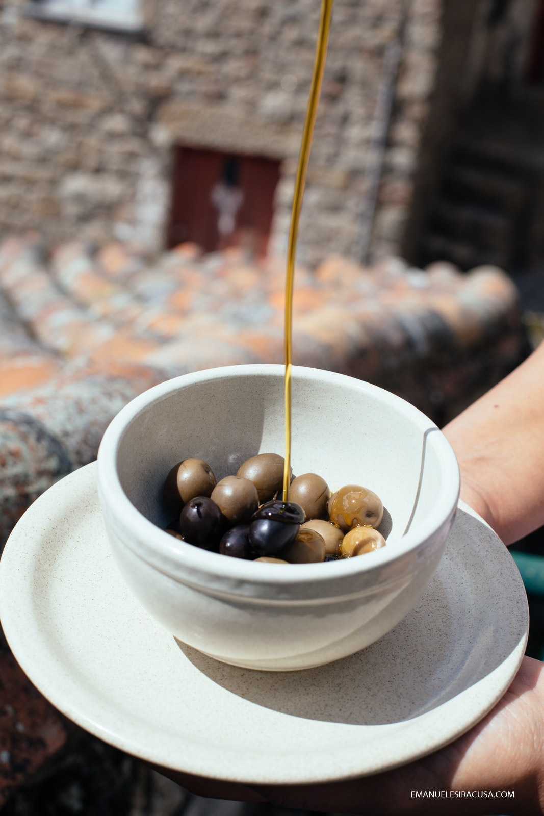 Olive oil is poured on olives, 2016