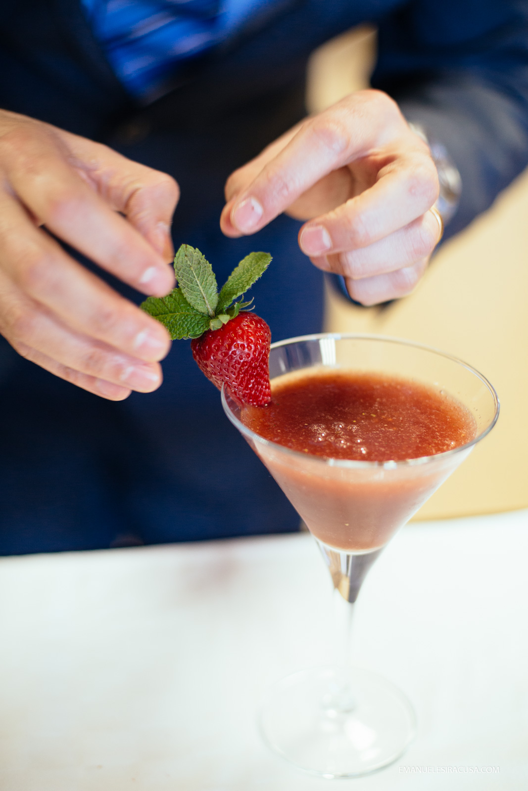 a teacher at the professional school in Fundao gives the finishing touches to a cherry and strawberry based daiquiry cocktail, Fundao, 2016